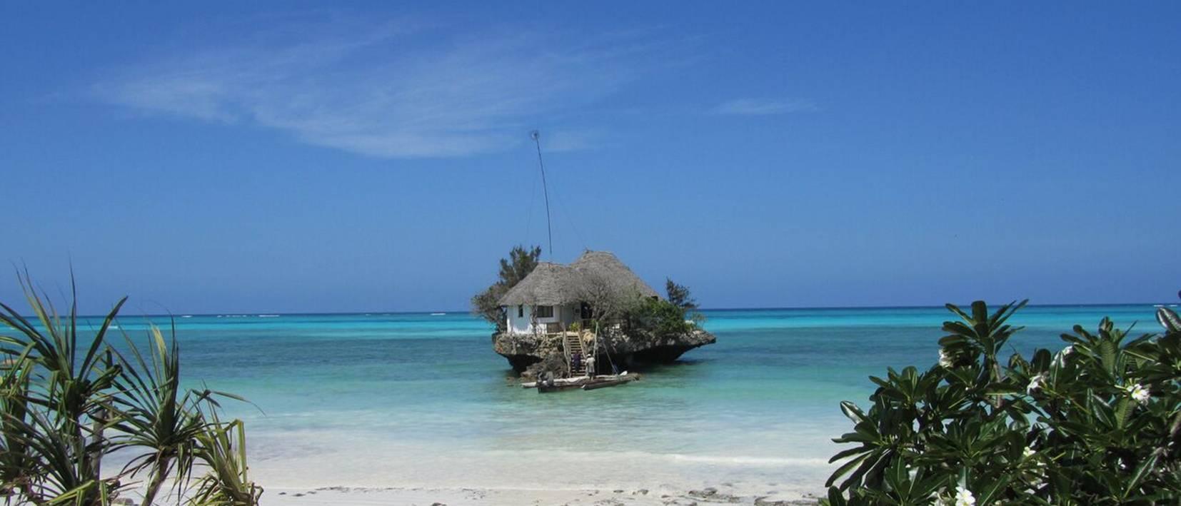 single house on island in blue ocean