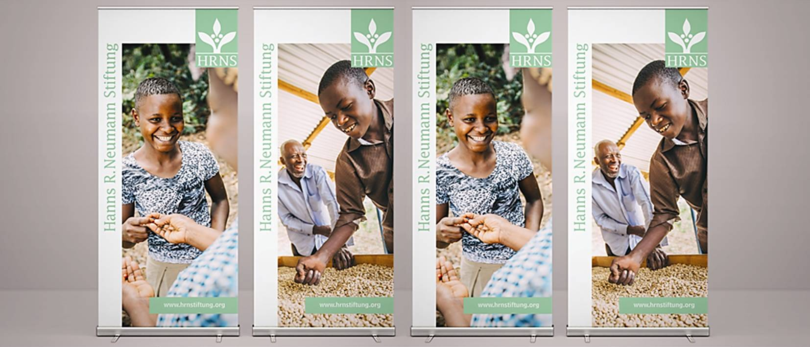 four large roll-up banners