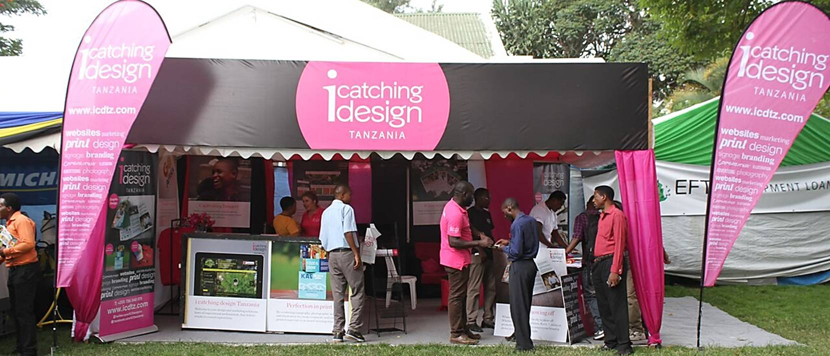 i catching design stand on grass with people chatting