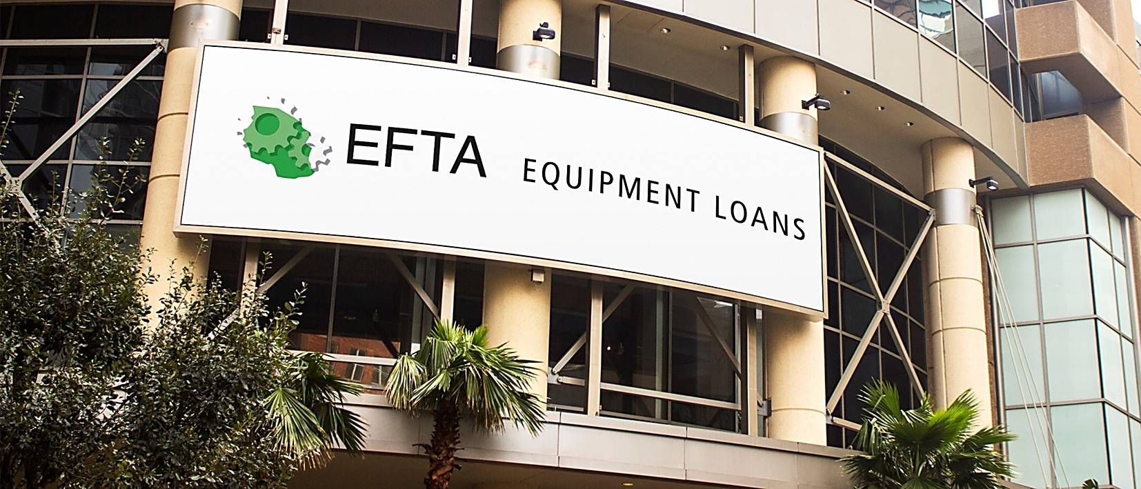 large efta sign on building with palm trees